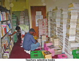 TEacher Selecting Books